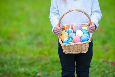 hand basket: Child holding a basket with easter eggs Stock Photo