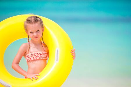 kids playing beach: Adorable little girl at beach during summer vacation
