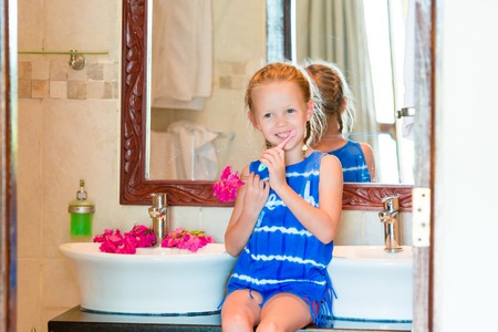 hygeine: Dental hygiene. Adorable little smile girl brushing her teeth