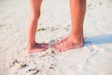 sandy feet: little girl with feet at the white sandy beach Stock Photo