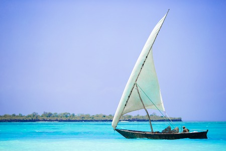 caribbean climate: Small wooden boat in stunning turquoise water Stock Photo