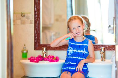 hygeine: Little girl brushing her teeth in bathroom Stock Photo