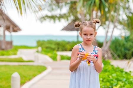 honey blonde: Adorable little girl having breakfast at resort restaurant