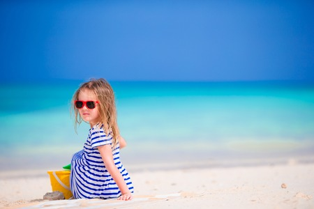 kids playing beach: Adorable little girl playing with beach toys during summer vacation Stock Photo