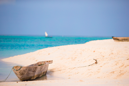 wooden boat: Small wooden boat in stunning turquoise water Stock Photo