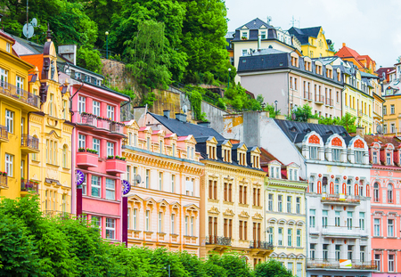 Tall hotels and traditional buildings on sunny street in Karlovy Vary, Czech Republic