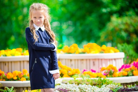 smilling: Cute smilling little girl posing in front of their school Stock Photo