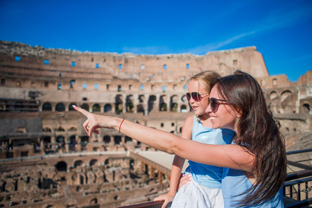 Happy family in Rome over Coliseum background Standard-Bild