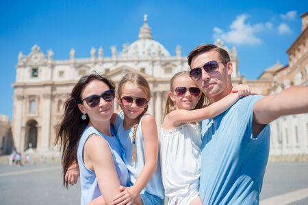 take a history: Happy family taking selfie in Vatican city and St. Peters Basilica church, Rome, Italy Stock Photo