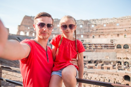 Happy family in Rome over Coliseum background Stock Photo