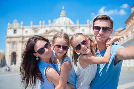 Happy family taking selfie in Vatican city and St. Peters Basilica church, Rome, Italy Stock Photo
