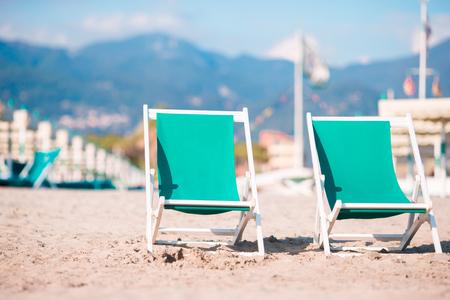 forte: Deckchairs on european beach in Italy, Forte