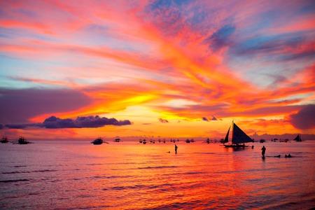 boracay: Sailing boat to the sunset in Boracay island on Philippines Stock Photo
