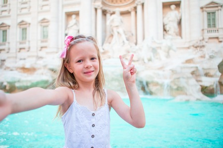 Little beautiful girl near fountain Fontana di Trevi Stock Photo