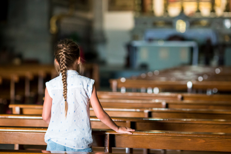 Child in beautiful old church in small european city
