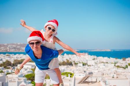 village man: Family in Santa Hats enjoy vacation with beautiful view