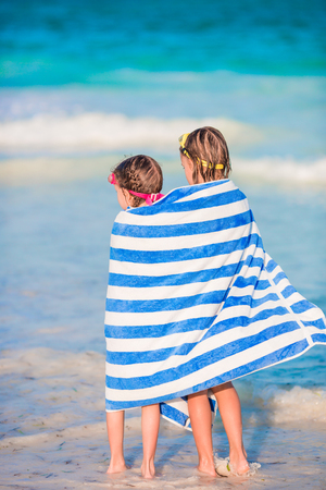 Adorable little girls wrapped in towel at tropical beach Stock Photo
