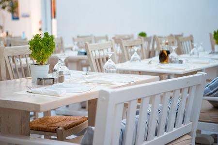 Summer empty openair cafe at greek city Stock Photo