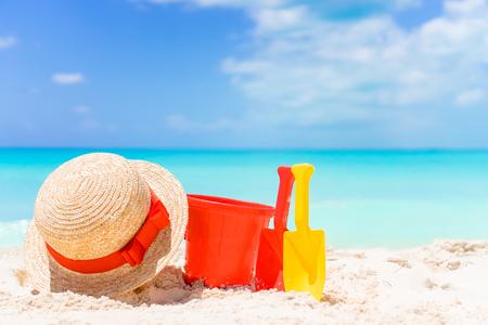 Kids beach toys on white sandy beach Stock Photo