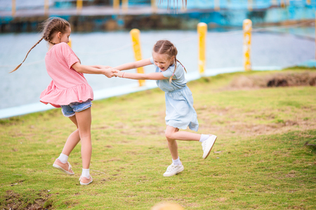 Adorable little girl have a lot of fun on summer vacation