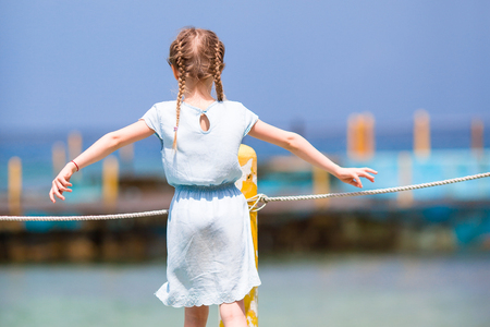 Little girl at the beach during caribbean vacation