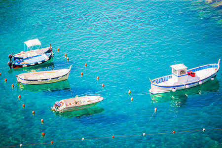 Beautiful cozy bay with boats and clear turquoise water in Italy, Europe Stock Photo