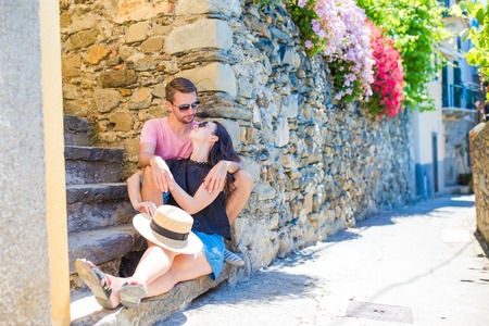 Happy couple traveling at italian old village on european holidays outdoors in Cinque Terre