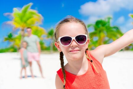Portrait of adorable little girl during beach vacation having fun