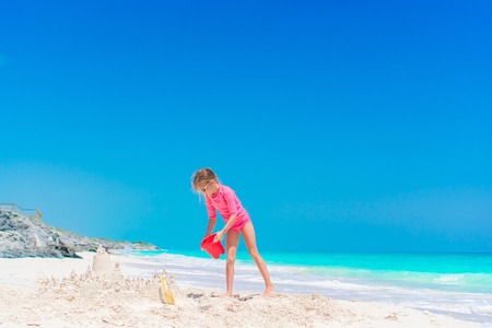 Little girl play with beach toys during tropical vacation Stock Photo