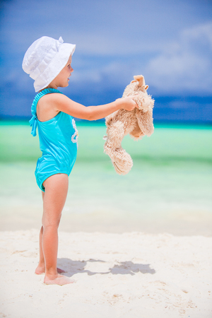 Cutie little girl at beach during summer vacation