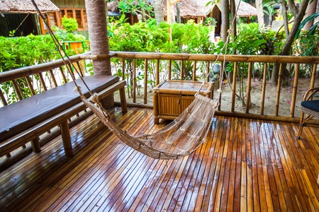 Hammock on terrace of cozy room in hotel in summer day Stock Photo