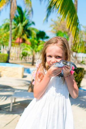 Adorable little girl with a small turtle in her hands in the natural reserve Stock Photo