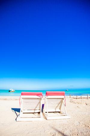Beach sunbeds on white sand beach