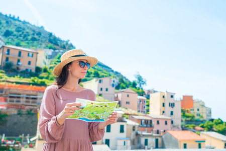 Young Woman With Map At Old Village Riomaggiore, Cinque ... on coastline of cinque terre map, tuscany vineyards map, italy map,
