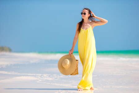 Young beautiful woman relaxing at white sand tropical beach Standard-Bild