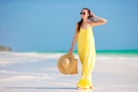 Young beautiful woman relaxing at white sand tropical beach Reklamní fotografie