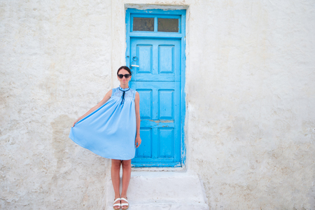 Beautiful woman in greek village. Young beautiful woman on vacation in Mykonos