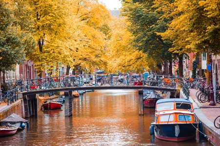 Beautiful canal in autumn in the old city of Amsterdam, Netherlands, North Holland province.