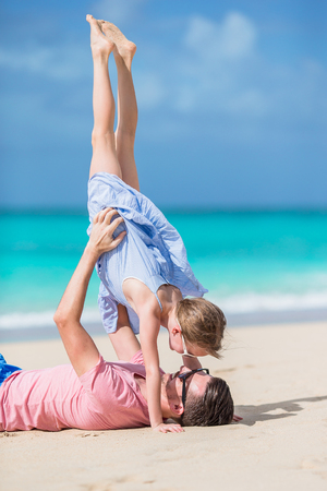 Little girl and happy dad having fun on the beach Stock Photo