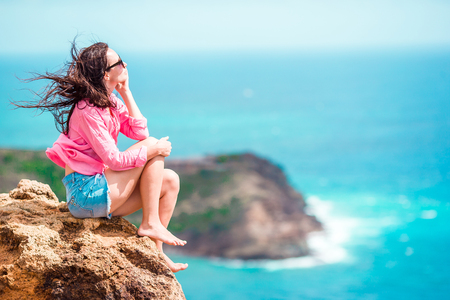 Young woman enjoying breathtaking views from Shirley Heights on tropical Antigua island in Caribbean Stock Photo