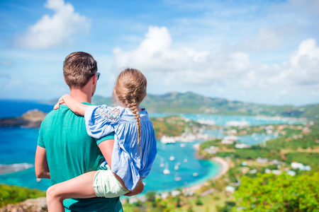 Family of dad and little kid enjoying the view of picturesque English Harbour at Antigua in caribbean sea Stock Photo