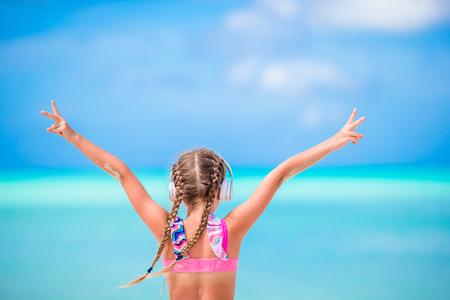 Little adorable girl on the beach