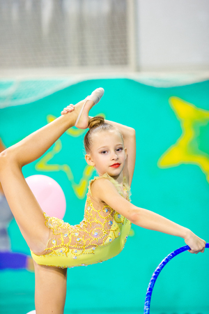 Little beautiful gymnast in competitions of rhythmic gymnastics