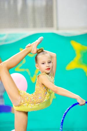 Little beautiful gymnast in competitions of rhythmic gymnastics
