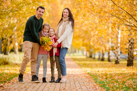 Portrait of happy family of four in autumn day Stock Photo