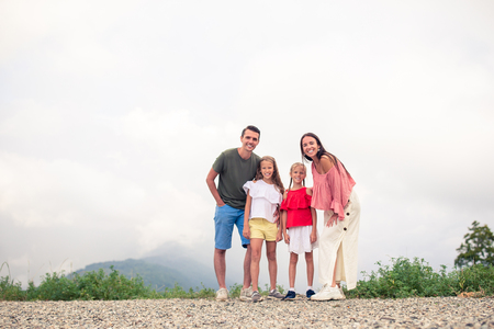 Beautiful happy family in mountains in the background of fog Stock Photo