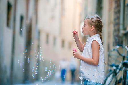 Adorable fashion little girl outdoors in European city Rome