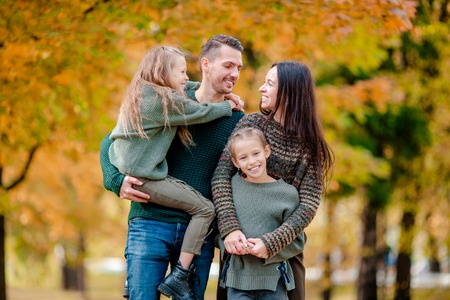Portrait of happy family of four in autumn Stock Photo