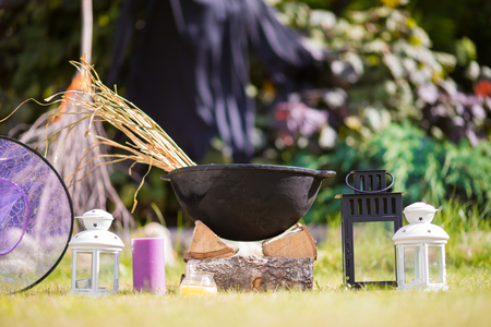 View of Halloween Pumpkins, witchs hat and rake outdoor Stock Photo