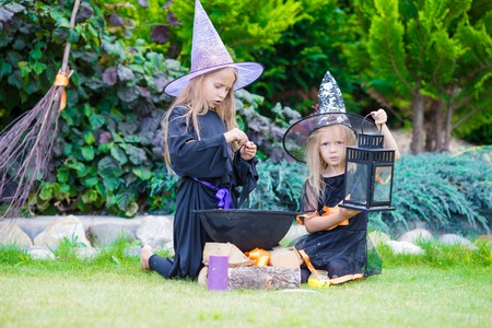 Happy girls in halloween costume with jack pumpkin.Trick or treat
